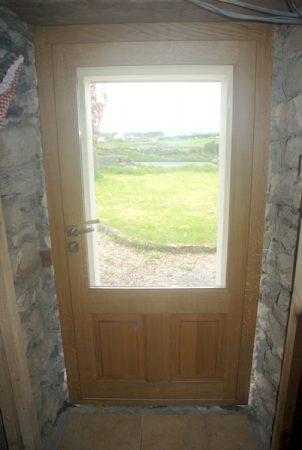 Vue interieure de porte d'entrée vitrée