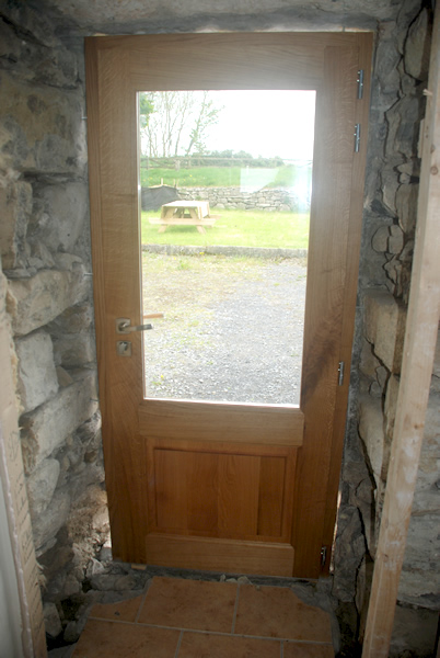Porte de service vitrée en chêne